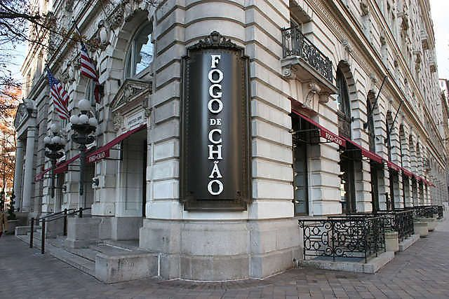 """Located in Washington DC, Fogo de Chao is a Brazilian restaurant serving all-you-can-eat meat in the """"continuous service"""" style.  Instead of ordering 1 or 2 items from the menus, servers will come around with large portions of meat for you to request at your desire.  Find Fogo de Chao on www.boomerang-dining.com."""