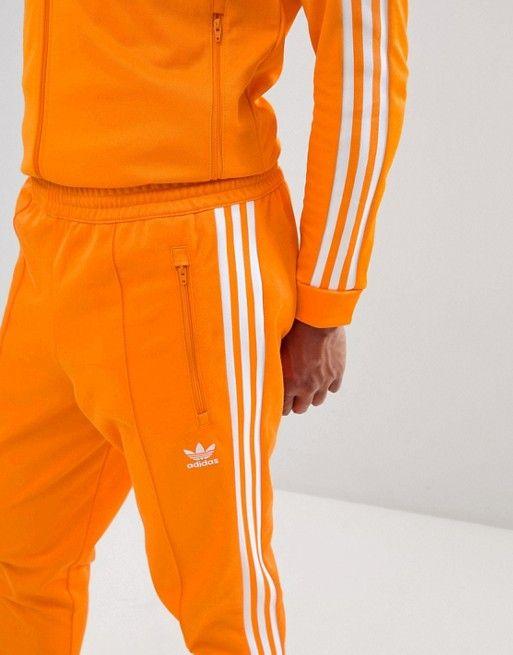 65c00b146cf2 adidas Originals Beckenbauer Sweatpants In Orange DH5819