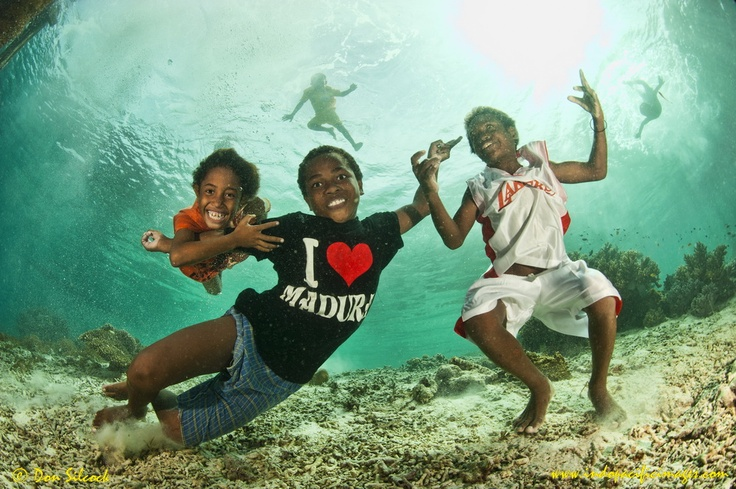 The village kids from Airborek in the Dampier Strait, Raja Ampat.    Perfect models, who never seem to tire.....