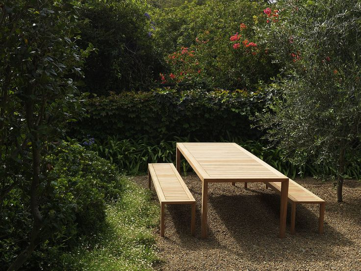 Dickie dining table and benches by Robert Plumb
