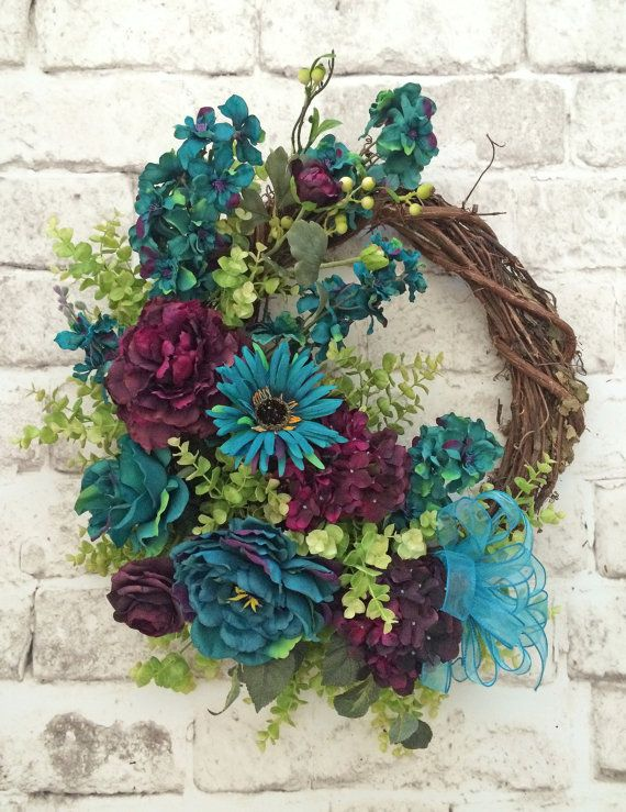 Vibrant Silk Flower Wreath, Grapevine Wreath, Front Door Wreath, Outdoor Wreath, Etsy -  Welcome your guests into your home with this gorgeous, silk floral wreath hanging on your front door. This wreath was handmade using a natural, rustic, grapevine wreath base adorned with an abundance of teal and plum silk flowers, lush artificial greenery, moss, and a sheer teal bow. This wreath would look so beautiful displayed on your wall, mantel, or front door!  • Already made and ready to ship! •…
