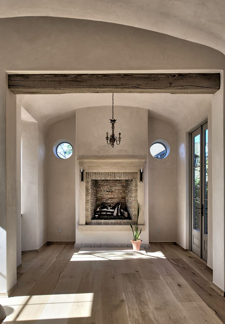 Dining room with raised fireplace.  markcristofalo