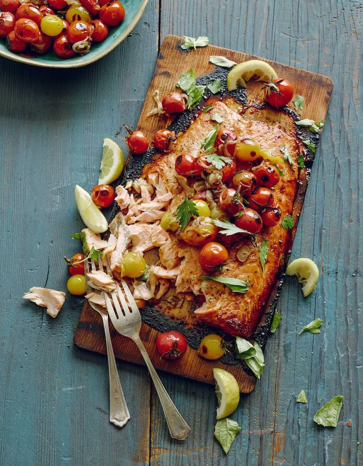 This cedar plank salmon with blistered tomatoes is a great, healthy dinner choice