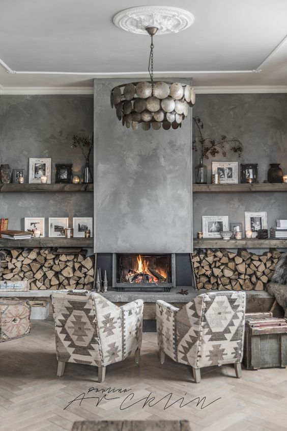 This is very interesting. This colour scheme would naturally give a cold feel but in this bright room it works. Not only because of the light and space but the wooden elements and real fire warms it up nicely #interestinginteriors