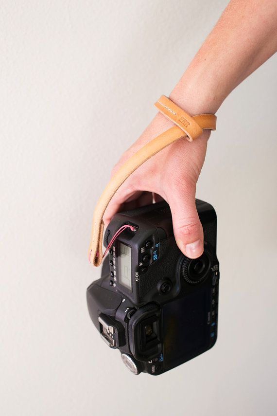 Universal leather camera wrist strap with a simple loop-through design makes it easy to use for your small point-and-shoot or your large SLR