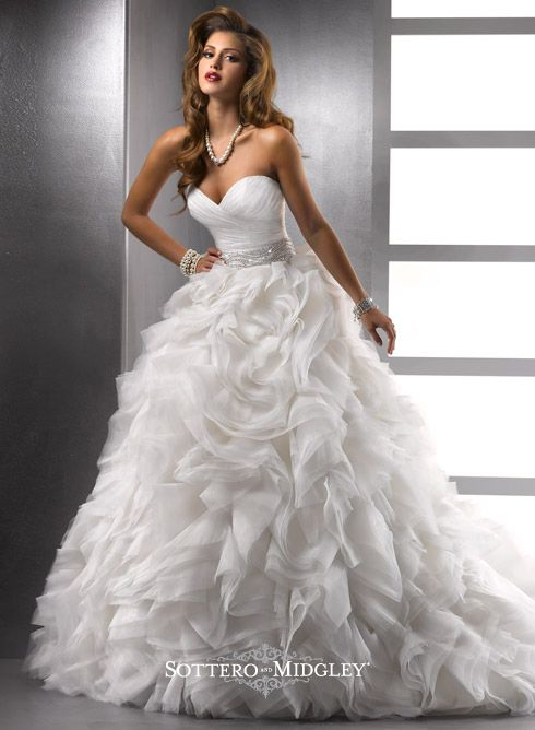 Big deal skirt with bejeweled belt and clean sweetheart bodice. This skirt has a train that demands a great hall in a palace. Go big winter wedding with a long, long veil, or a white mink shrug for photos