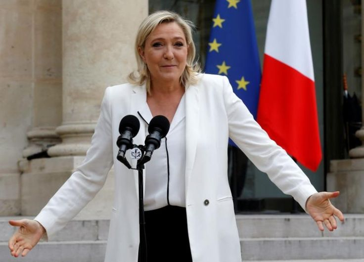 Marine Le Pen, France's far-right National Front political party leader, talks to journalists following a meeting with French President Francois Hollande (not pictured) after Britain's vote to leave the European Union, at the Elysee Palace in Paris, France, June 25, 2016.  REUTERS/Jacky Naegelen