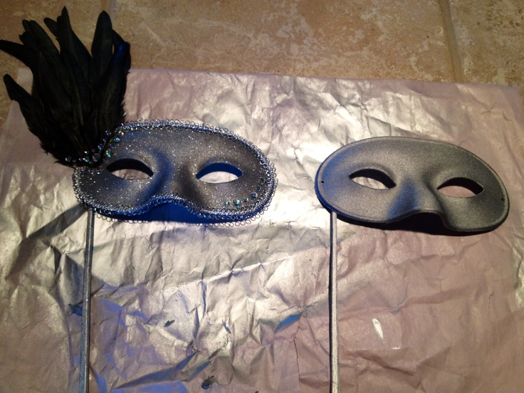 DIY masquerade mask. Plain white mask, spray paint silver, silver glitter, feather, fancy ribbon and sequins! Decorate away!