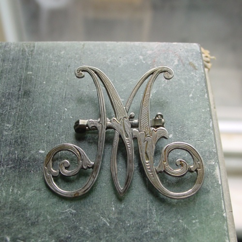 Victorian silver chased monogram brooch.