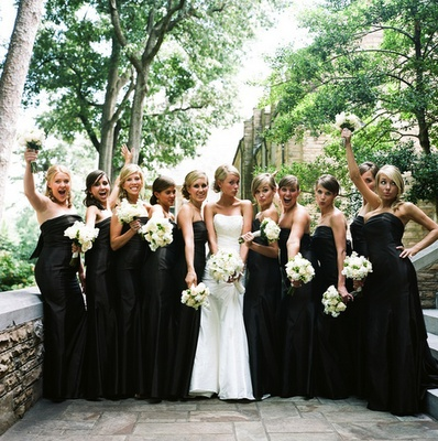 Love how the wedding dress pops next to the black bridesmaid dresses!!