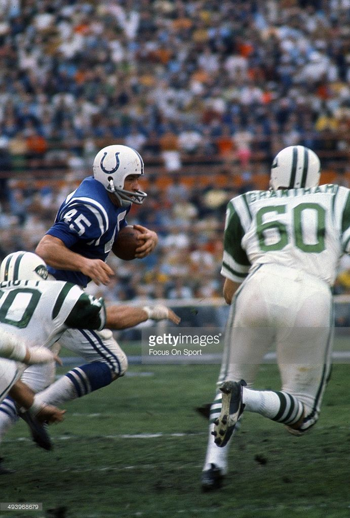 Jerry Hill #45 of the Baltimore Colts carries the ball pursued by John Elliott #80 and Larry Grantham #60 of the New York Jets during Super Bowl III at the Orange Bowl on January 12, 1969 in Miami, Florida. The Jets defeated the Colts 16-7.