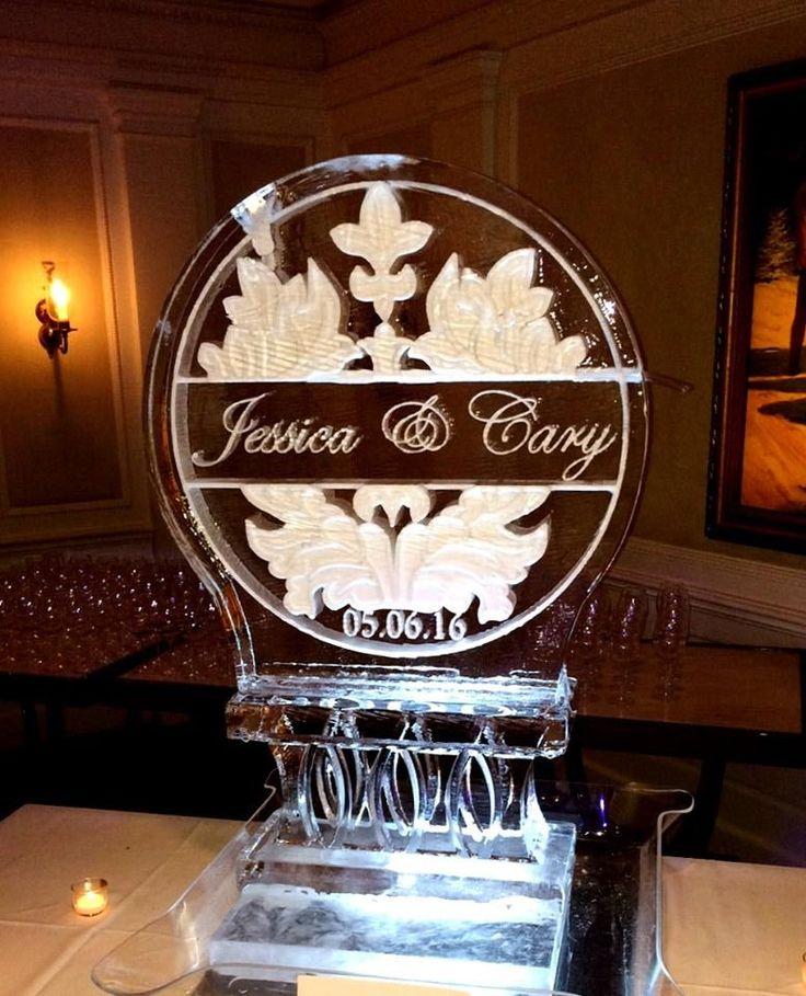 "Wedding themed ice luge using our 30"" square ice block for a wedding reception. #icesculptures #weddingice #weddingdecor"