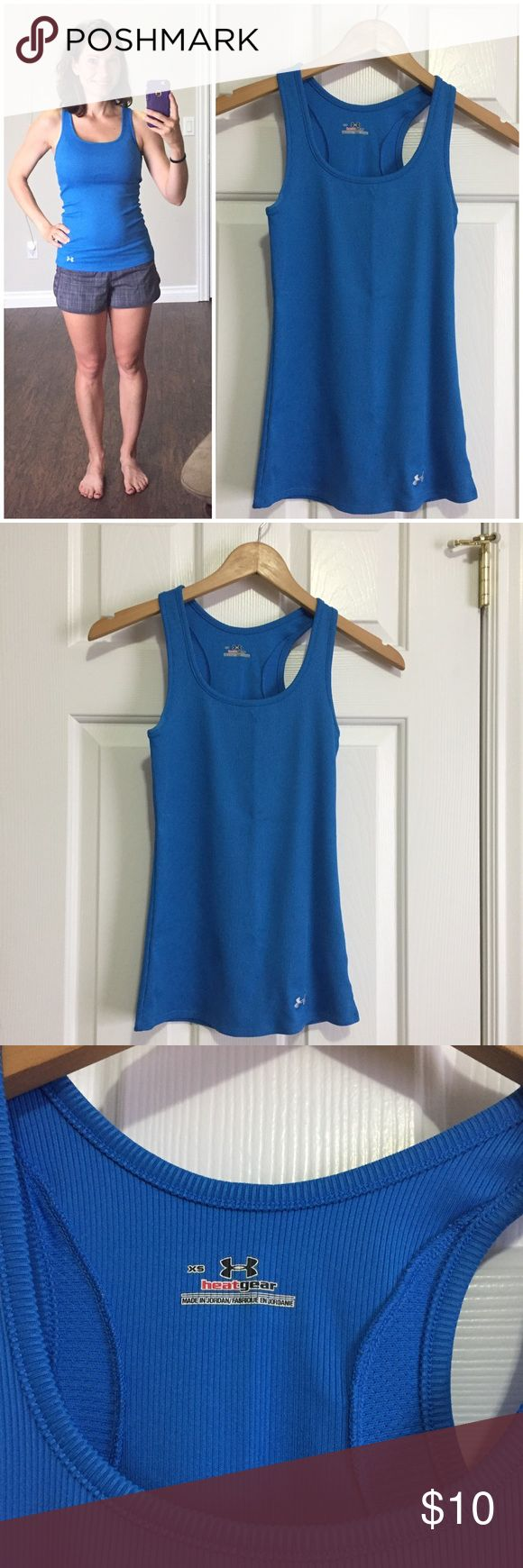 """Under Armor varsity tank Beautiful cobalt blue Under Armor running or workout tank. Stretchy wicking material keeps you dry as you sweat, perfect for high intensity activities like running or just wearing to the zoo on a hot day! Mesh inserts along the back for additional cooling. Racerback style. I LOVE these tanks and own like 15 of them, I am only selling this one because it is XS and rides up on me slightly (Small fits me perfectly). Fitted style, length is 24"""". One small mark near logo…"""