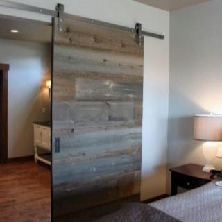 sliding barn door made with reclaimed barn wood old wood meets modern design