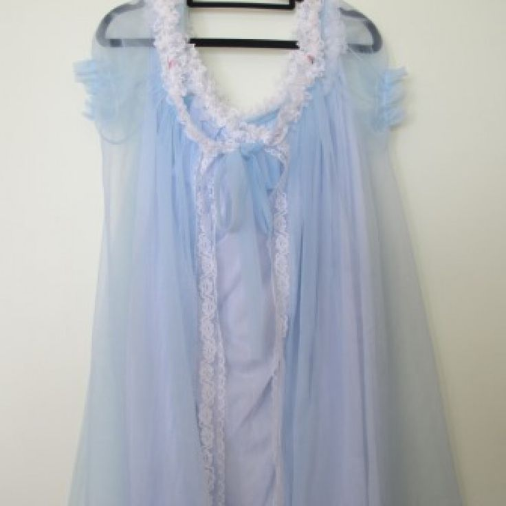 "Vintage 1950\'s Powder Blue Negligee set on Velvet Rose's Pin Up Dressing Room  True Vintage powder blue negligee set, sheer negligee, with white lace and tiny pink rosebuds. Low neck with narrow lace shoulder straps continuing around the neckline, then it just billows flows to a modest below the knee length from tip to toe approx 42"", bust width would suit suit 34"", 36"" or even 38""."
