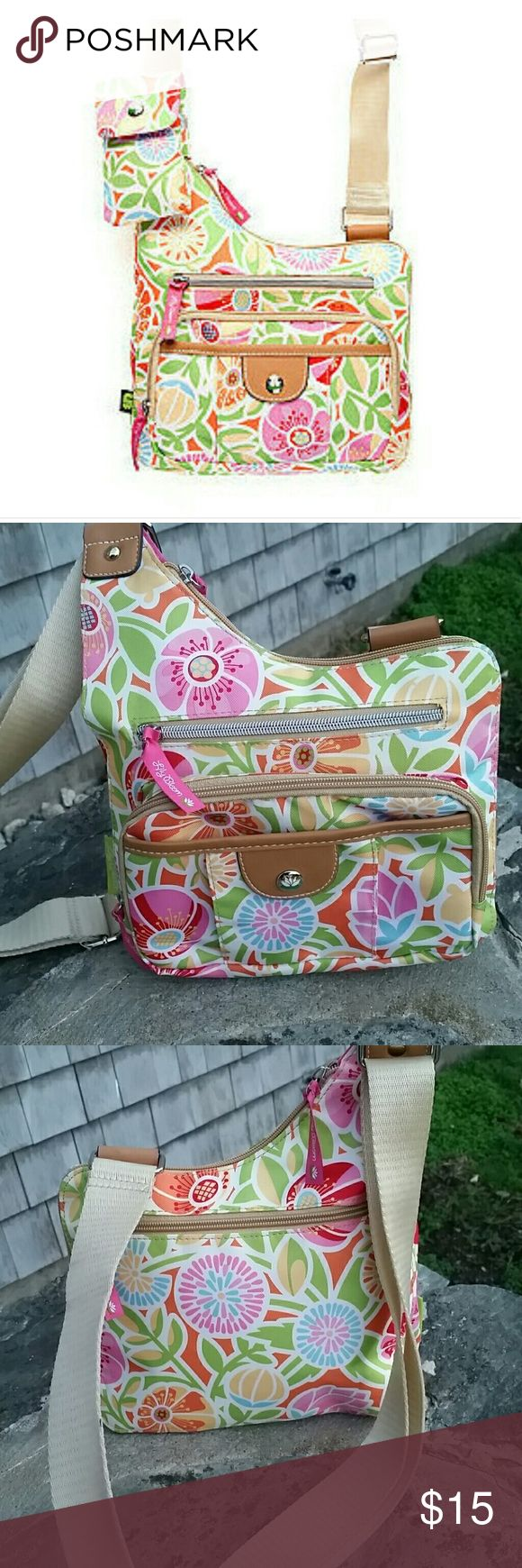 Lily Bloom Crossbody purse NWOT never been used stylish and practical purse with plenty of pockets. Bright fun color. Missing attachable coin purse other wise perfect. Lily bloom  Bags Crossbody Bags