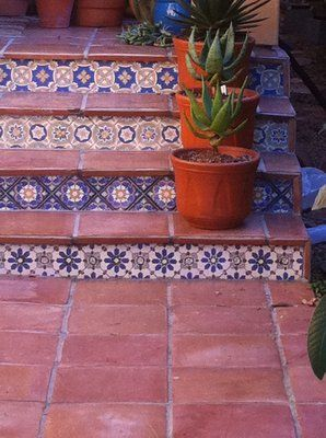 Mexican tile create a beautiful point of interest for this back patio