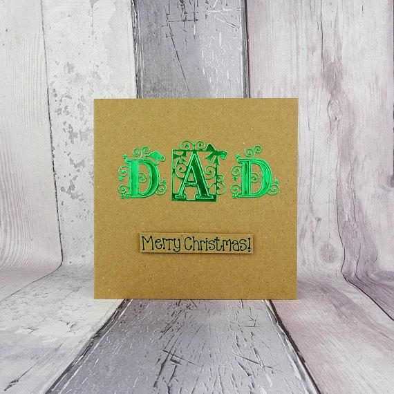 This special font Christmas card for Dad is handmade and you can choose the colour of the foiled card that spells out the name: Dad. The special font has swirls, stars and an elf hat entwined in the lettering spelling out: Dad. The sentiment on this handmade Christmas card is in the matching colour ink to to the large letters and then added to the card with 3D foam and reads: Merry Christmas! Or you can choose any of the messages from the drop-down menu, or create your own and add it to the…