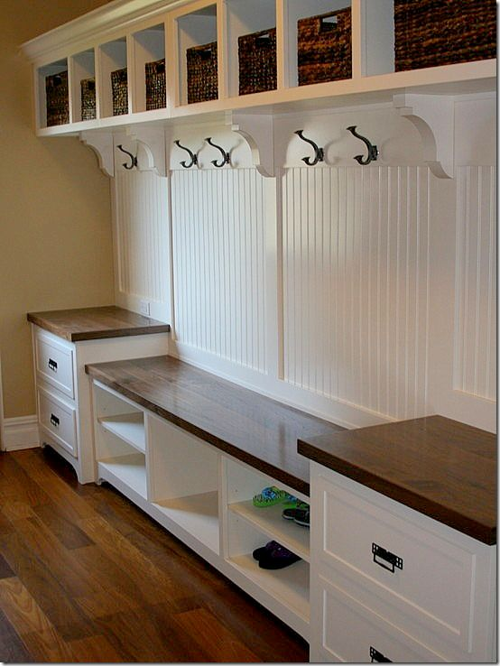 Love the bench in the middle of the two cabinets