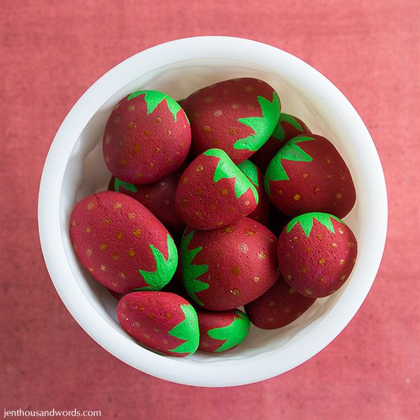 Painted strawberry stones to keep the birds from eating the berries on your plants.