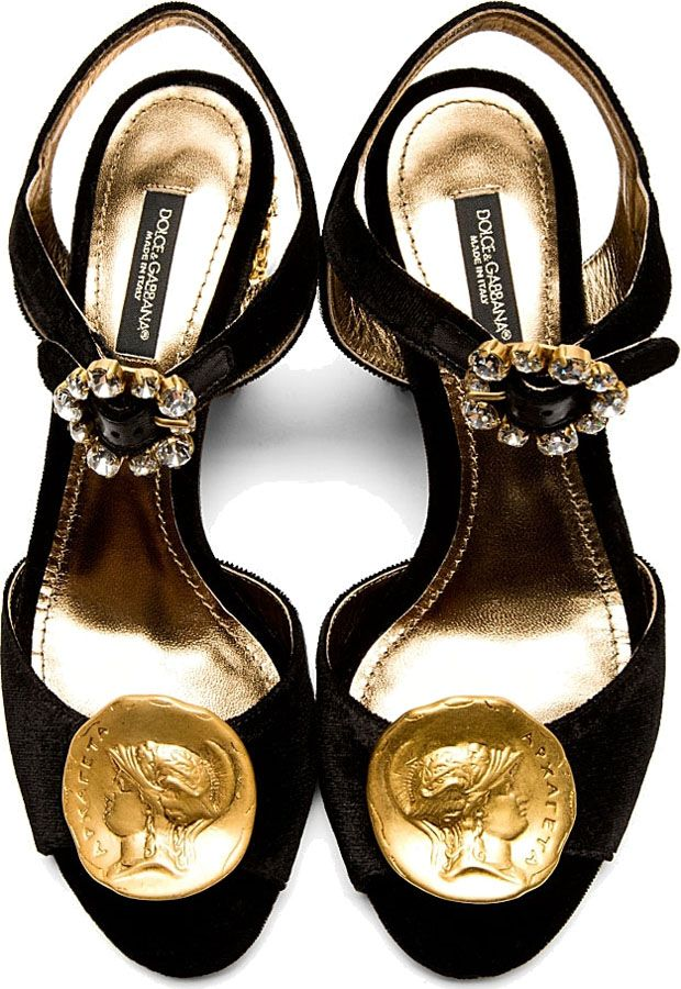 Velvet heeled sandals in black. Round open toe. Pin-buckle closure with crystal-cut embellishments at adjustable ankle strap. Gold-tone hammered Roman coin detail at toe. Designed by Dolce & Gabbana. http://zocko.it/LD4Nh