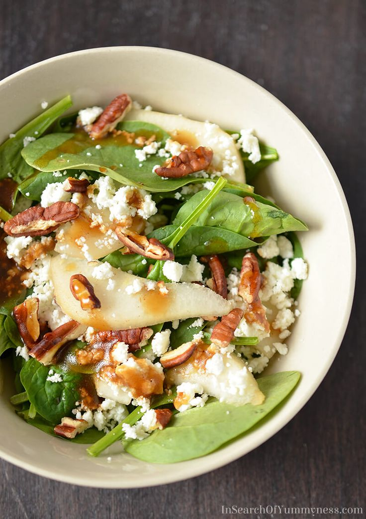 If you like spinach salads, you're going to LOVE this Spinach Salad with Pears, Pecans and Goat Cheese! Get the recipe at InSearchOfYummyness.com.