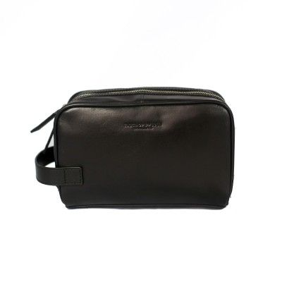 TIGER OF SWEDEN  TIGINO LEATHER TOILET BAG  €120  A spacious and stylish toilet bag in leather from Tiger of Sweden. Has a large main compartment that closes with a zipper and small compartments on the inside. Absolutely perfect for those who travel a lot and like the neat design.