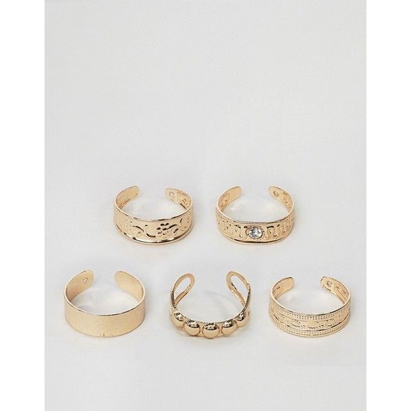 Monki 5 Pack Festival Toe Rings (12 AUD) ❤ liked on Polyvore featuring jewelry, rings, gold, toe rings, monki, steel ring and steel jewelry