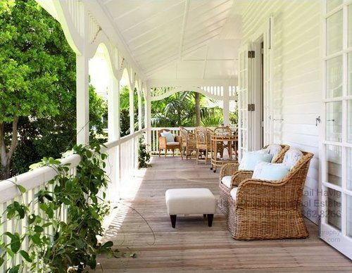Wrap around porch with a swing and white picket fence is a must.
