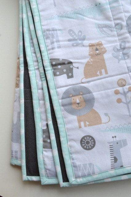 Square Baby Quilt: Aqua and Grey Safari Animals. This super soft and cushy baby blanket is made with 100% cotton quilting fabric, 100% cotton batting, and