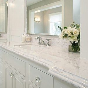 White Bathroom Countertops And Pale Grey Cabinets For A