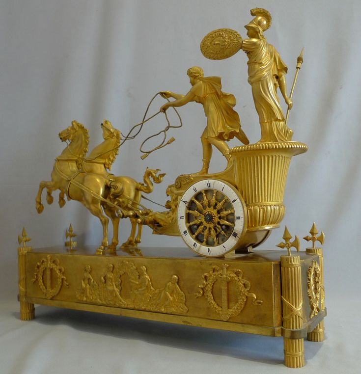 ** French Empire antique mantel clock of Minerva riding the chariot of Diomedes. - Gavin Douglas Antiques