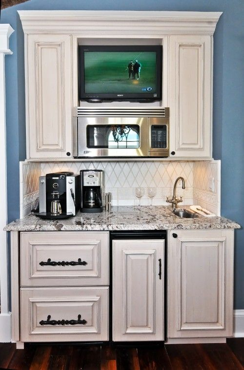 This may be the most perfect thing I've ever seen!!!  Keeps everyone out of the kitchen in the morning (make your own coffee, get your own juice) and out of the kitchen during a party (close by, but not IN it).  AND there's a TV!