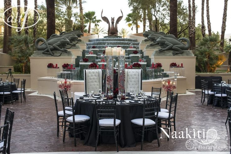 White tufted chairs for the Bride & Groom at the head table.