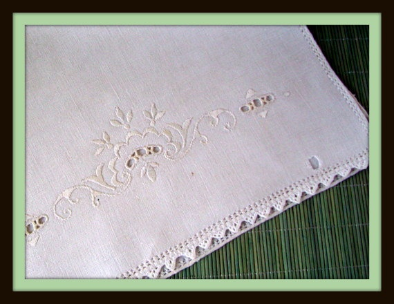 Vintage Embroidered Linen White on White Cutwork Table Scarf. $8.00, via Etsy.