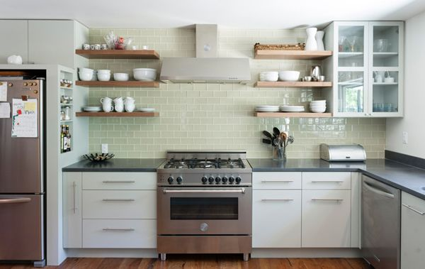ktichen vent hood with backsplash | The back wall of the kitchen features a Bertazzoni range and vent hood ...