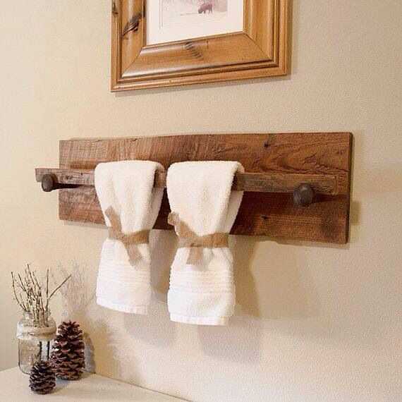Love this rustic towel holder