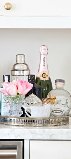 Lovely little drinks tray. I like the styling with cute vase of flowers to make it more feminine. Choose classy bottles.