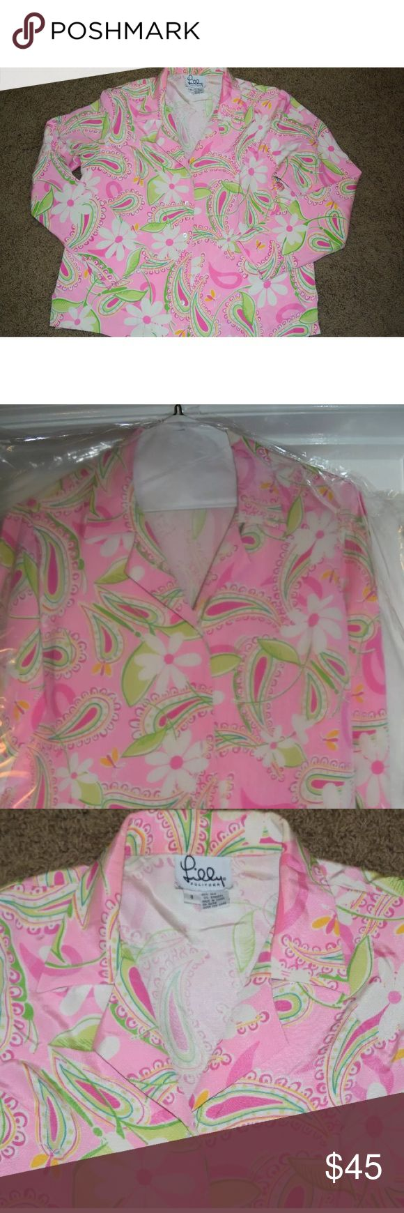 """Women's 8 Lilly Pulitzer Pink Floral Blouse Shirt Women's size 8 Pink Floral Button Down Blouse ~ 95% silk 5% spandex ~ shoulder to shoulder 17"""" ~ front shoulder to hem 23"""" ~ armpit to armpit 20.5"""" ~ sleeve inseam 18"""" ~ side vents 3"""" ~ White Lilly Pulitzer interior label ~ Blouse has been freshly dry-cleaned 🌸🛍💖 Lilly Pulitzer Tops Blouses"""