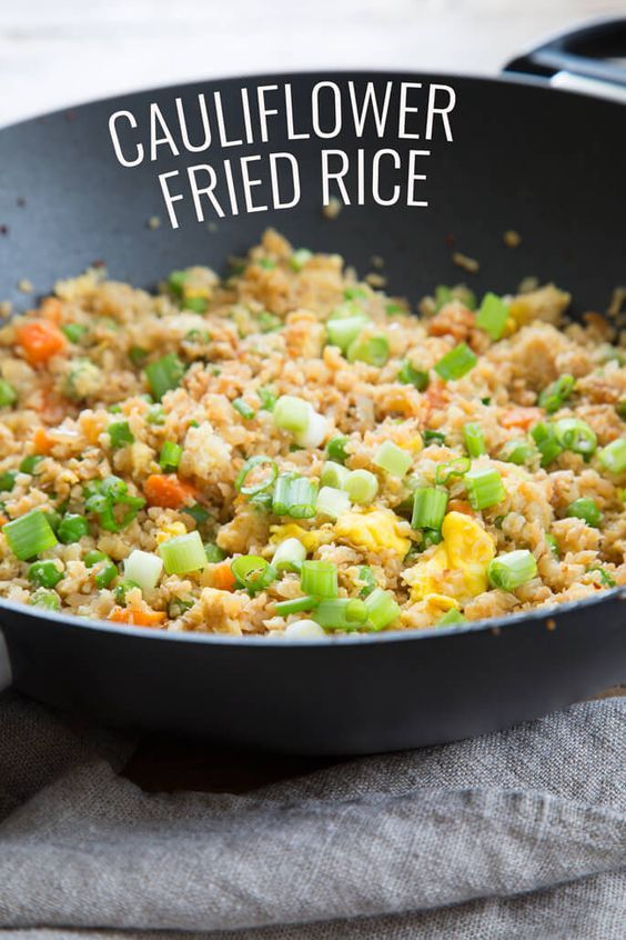 Tasty cauliflower fried rice. The low carb, Paleo recipe for takeout fake-out. Make riced cauliflower the easy way with frozen, defrosted cauliflower.