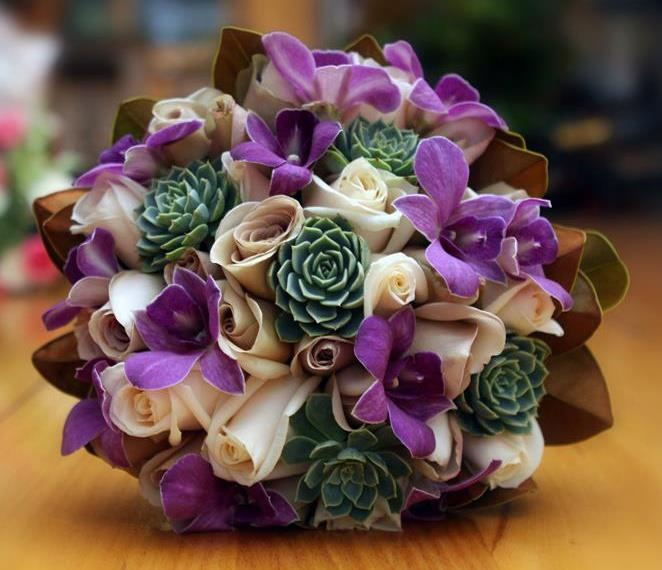Ivory & Metalina roses, with Succulents, purple Orchids & Magnolia foliage #weddings  http://www.RedEarthFlowers.com.au/