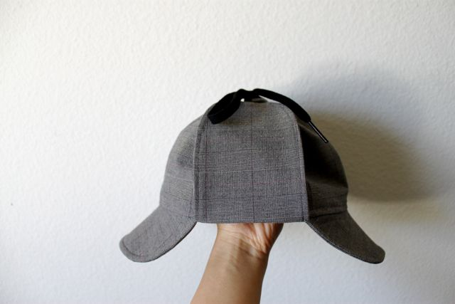 Cation Designs: Deerstalker.  It's a good basic idea of how to make one, but you have to know how to sew and cobble together a pattern to make it this way.