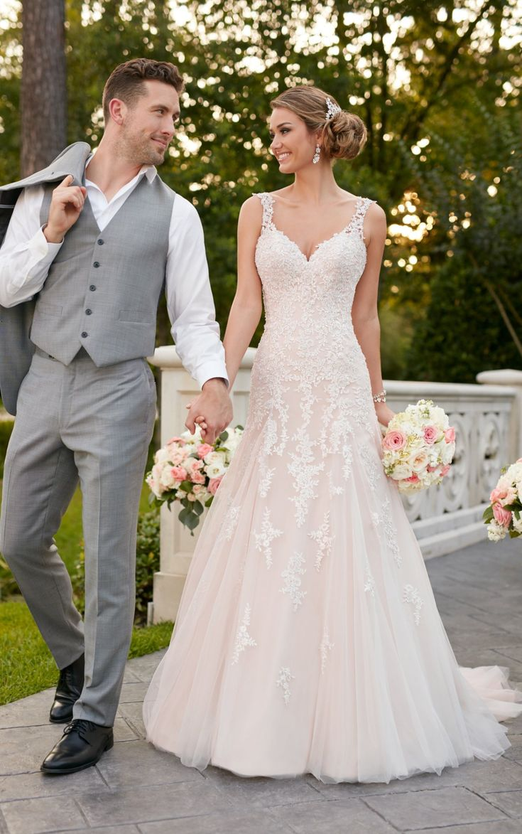 This sparkling silver lace wedding dress from Stella York is sure to be a show-stopper! The modern modified A-line silhouette boasts metallic lace.