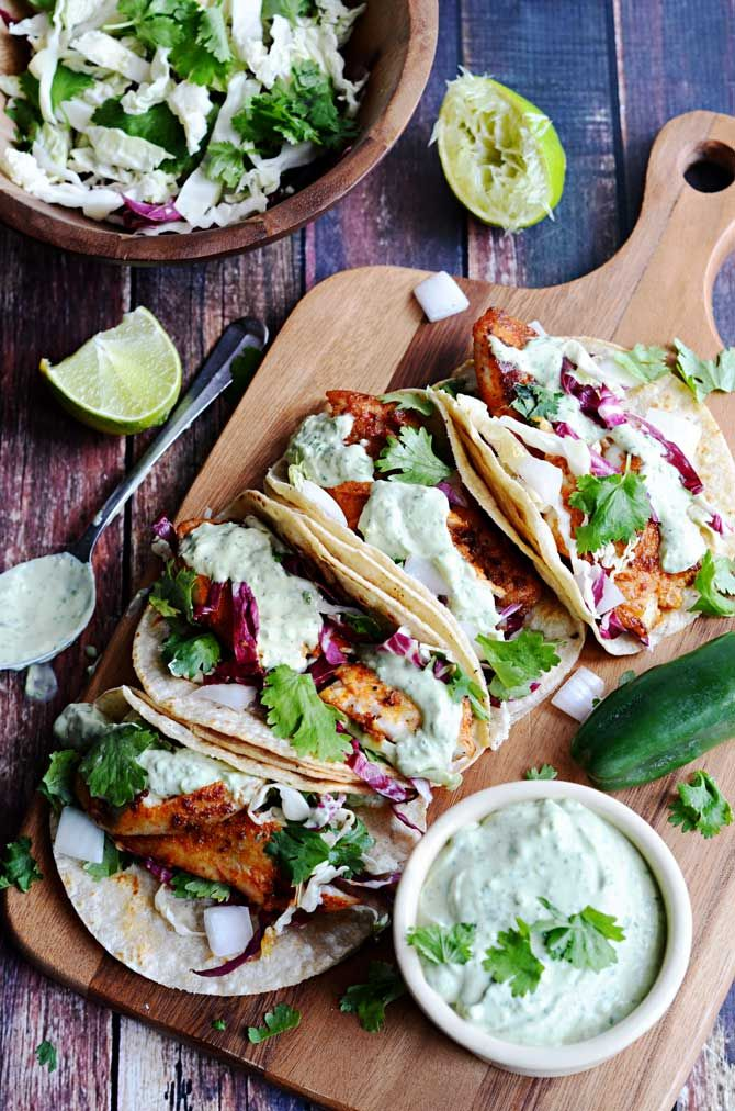Blackened Fish Tacos with Avocado-Cilantro Sauce.  hostthetoast.com