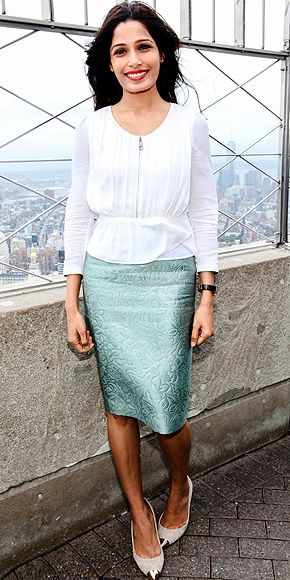 Freida Pinto. Skirt Burberry Prorsum Resort 2014. Where: 'International Day Of The Girl' The Empire State Building