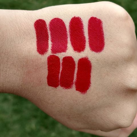 My collection of non liquid lipstick reds! These are all matte with the exception of one, which I will list down below. Colors from L-R FIRST ROW: Kiss Red (RK by Kiss (bought it on Amazon)), Red Rouge (Forever 21), Up the Bass (NYX full throttle), Eden (NYX matte lipstick). SECOND ROW L-R: Behr Hug (Colourpop crème), Bossy (Colourpop), & Trust Me (Colourpop)  #redlipstickcollection #redlipstick #redlipsticklover #redlips #mycollection #myphoto #outside #cloudy #handswatches #swatches…