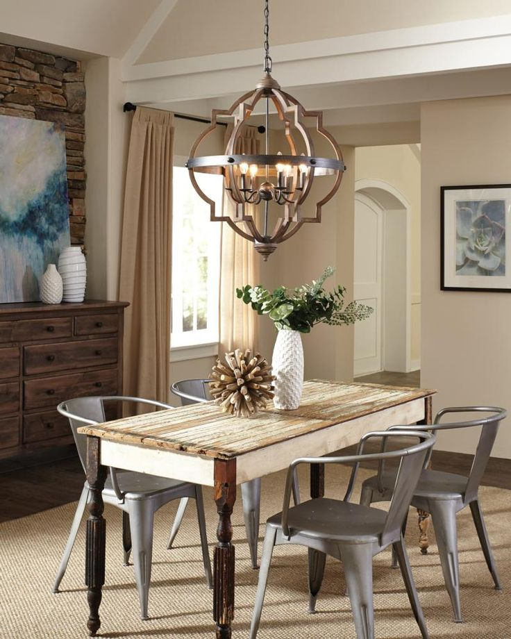 The Socorro Collection: The transitional Socorro lighting collection by Sea Gull Lighting features a classic, barbed Quatrefoil profile - wholly updated by combining a distressed Cerused Oak finish on the decorative silhouette with the rich Stardust finish on the metal bobeches and decorative strapping to create undeniable rustic charm. The collection includes four- and six-light hall/foyer pendants. Incandescent candelabra base lamping.