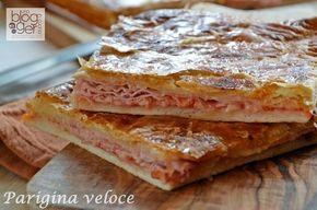 Parigina veloce, una pizza rustica semplice e veloce preparata con una base di pasta per pizza, un goloso e ricco ripieno e uno strato di pasta sfoglia.