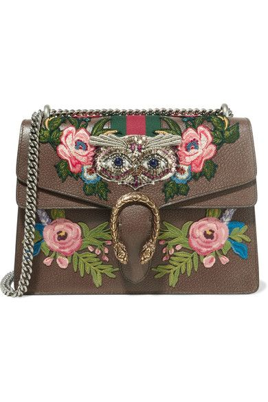 Dark-brown leather Push clasp-fastening front flap Comes with dust bag Weighs approximately 3.1lbs/ 1.4kg Made in Italy