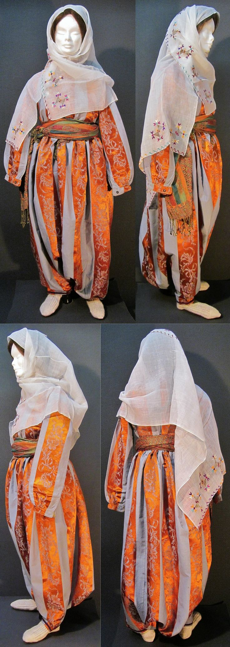 A traditional daily costume from the Konya province.  Middle-class urban style, worn at home, ca. 1900-1925.  Containing: a silk ensemble ('gömlek'/shirt + 'şalvar'/baggy trousers),  a large embroidered 'yazma' (headscarf) and a woven 'kuşak' (waist band).  All items are from the same period. (Kavak Costume Collection - Antwerpen/Belgium).